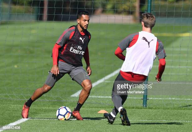 Theo Walcott and Nacho Monreal of Arsenal during a training session at London Colney on September 30 2017 in St Albans England