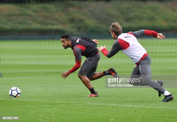 Theo Walcott and Nacho Monreal of Arsenal during a training session at London Colney on October 13 2017 in St Albans England