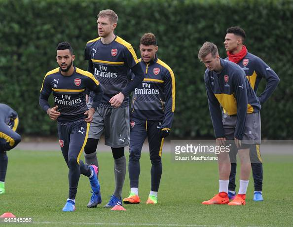 Theo Walcott and Per Mertesacker of Arsenal during a training session on February 19 2017 in St Albans England