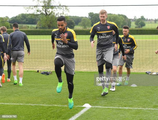 Theo Walcott and Per Mertesacker of Arsenal during a training session at London Colney on May 20 2017 in St Albans England