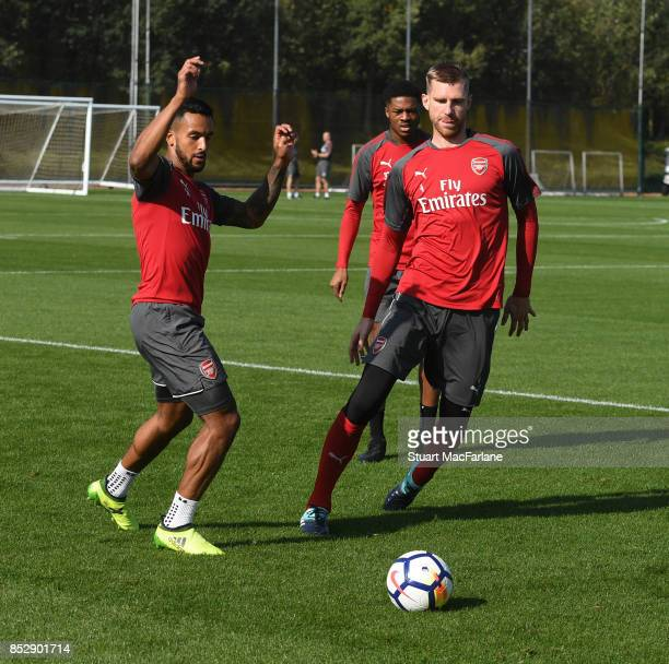 Theo Walcott and Per Mertesacker of Arsenal during a training session at London Colney on September 24 2017 in St Albans England