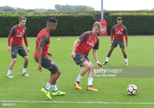 Theo Walcott and Rob Holding of Arsenal during a training session at London Colney on August 26 2017 in St Albans England