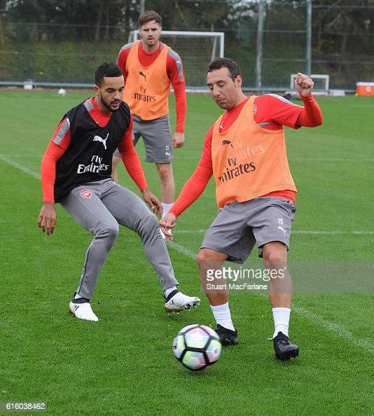 Theo Walcott and Santi Cazorla of Arsenal during a training session at London Colney on October 21 2016 in St Albans England