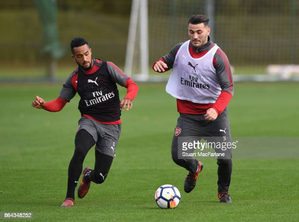 Theo Walcott and Sead Kolasinac of Arsenal during a training session at London Colney on October 21 2017 in St Albans England