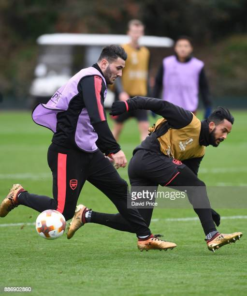 Theo Walcott and Sead Kolasinac of Arsenal during the Arsenal Training Session at London Colney on December 6 2017 in St Albans England