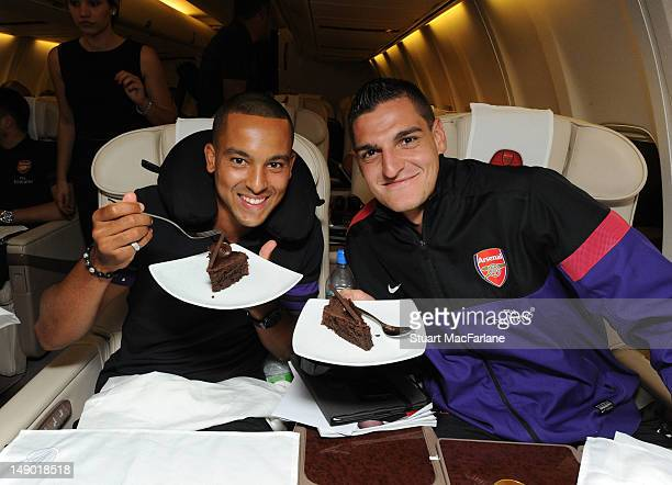 Theo Walcott and Vito Mannone on the team flight to Malaysia for the club's preseason Asian tour on July 21 2012 in London England