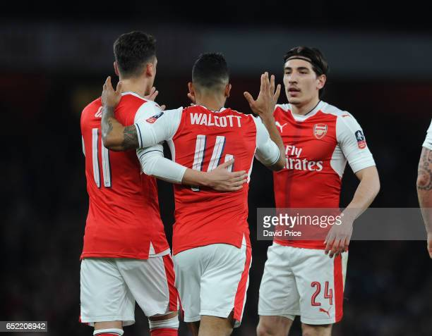 Theo Walcott celebrates Arsenal's 1st goal with Hector Bellerin and Mesut Ozil during the match between Arsenal and Lincoln City at Emirates Stadium...