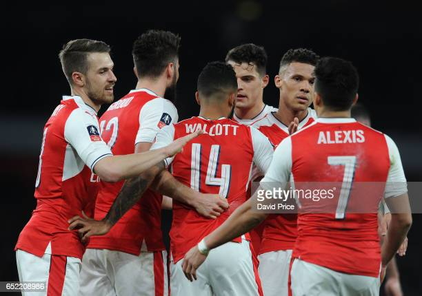Theo Walcott celebrates Arsenal's 1st goal with his team mates during the match between Arsenal and Lincoln City at Emirates Stadium on March 11 2017...