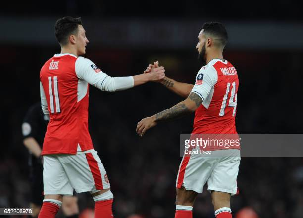 Theo Walcott celebrates Arsenal's 1st goal with Mesut Ozil during the match between Arsenal and Lincoln City at Emirates Stadium on March 11 2017 in...