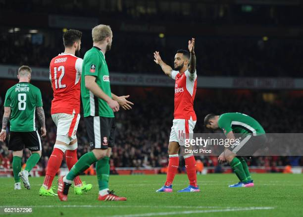 Theo Walcott celebrates scoring Arsenal's 1st goal during the match between Arsenal and Lincoln City at Emirates Stadium on March 11 2017 in London...