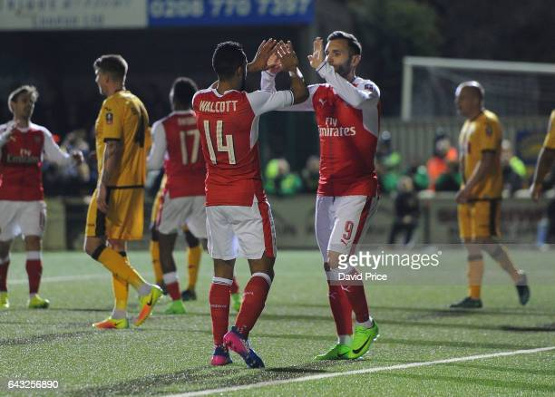 Theo Walcott celebrates scoring Arsenal's 2nd goal with Lucas Perez during the match between Sutton United and Arsenal on February 20 2017 in Sutton...