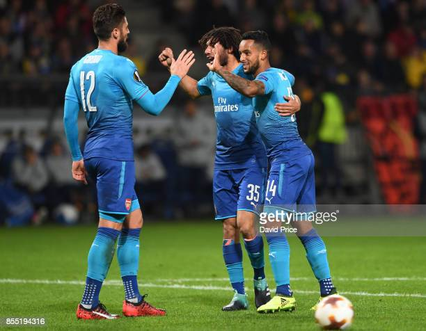 Theo Walcott celebrates scoring Arsenal's 2nd goal with Mohamed Elneny and Olivier Giroud during the UEFA Europa League group H match between BATE...