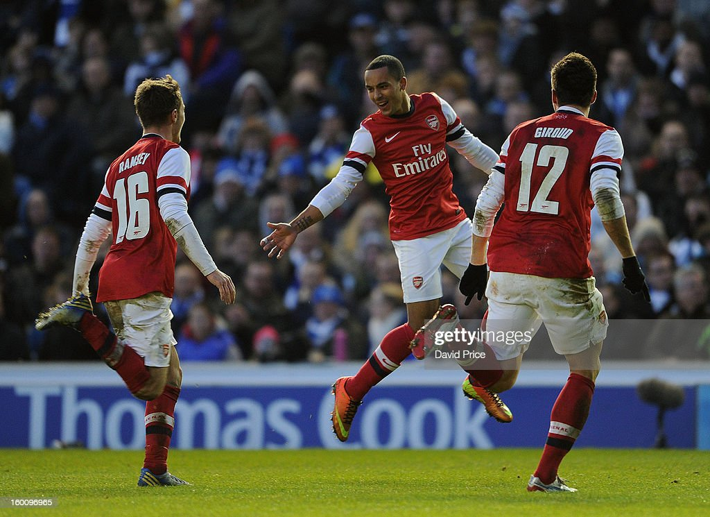 Theo Walcott celebrates scoring Arsenal's 3rd goal with Aaron Ramsey and Olivier Giroud during the FA Cup Fourth Round match between Brighton & Hove Albion and Arsenal at the Amex Stadium on January 26, 2013 in Brighton, England.