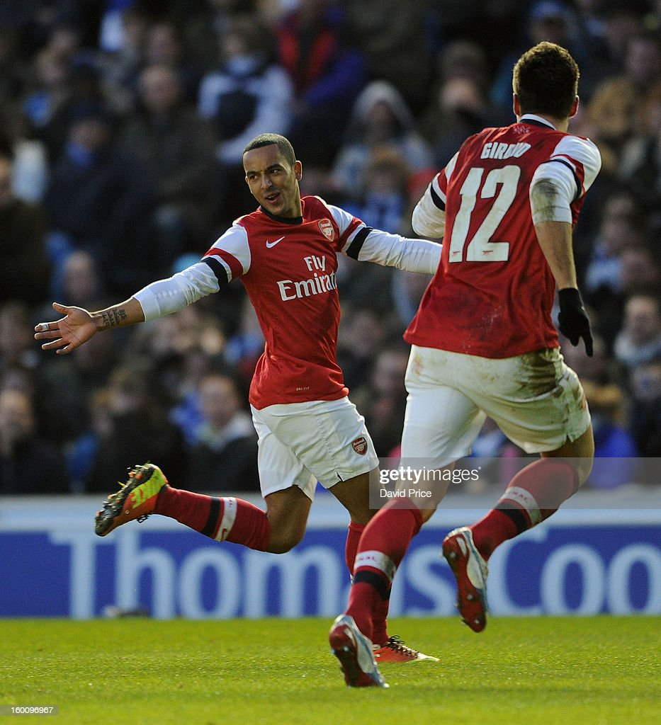 Theo Walcott celebrates scoring Arsenal's 3rd goal with Olivier Giroud during the FA Cup Fourth Round match between Brighton & Hove Albion and Arsenal at the Amex Stadium on January 26, 2013 in Brighton, England.