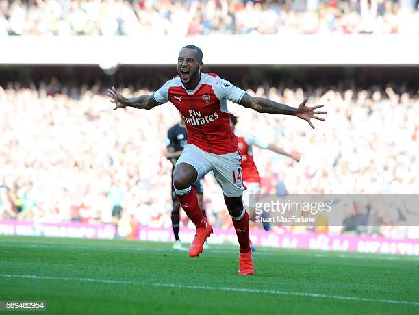 Theo Walcott celebrates scoring for Arsenal during the Premier League match between Arsenal and Liverpool at Emirates Stadium on August 14 2016 in...