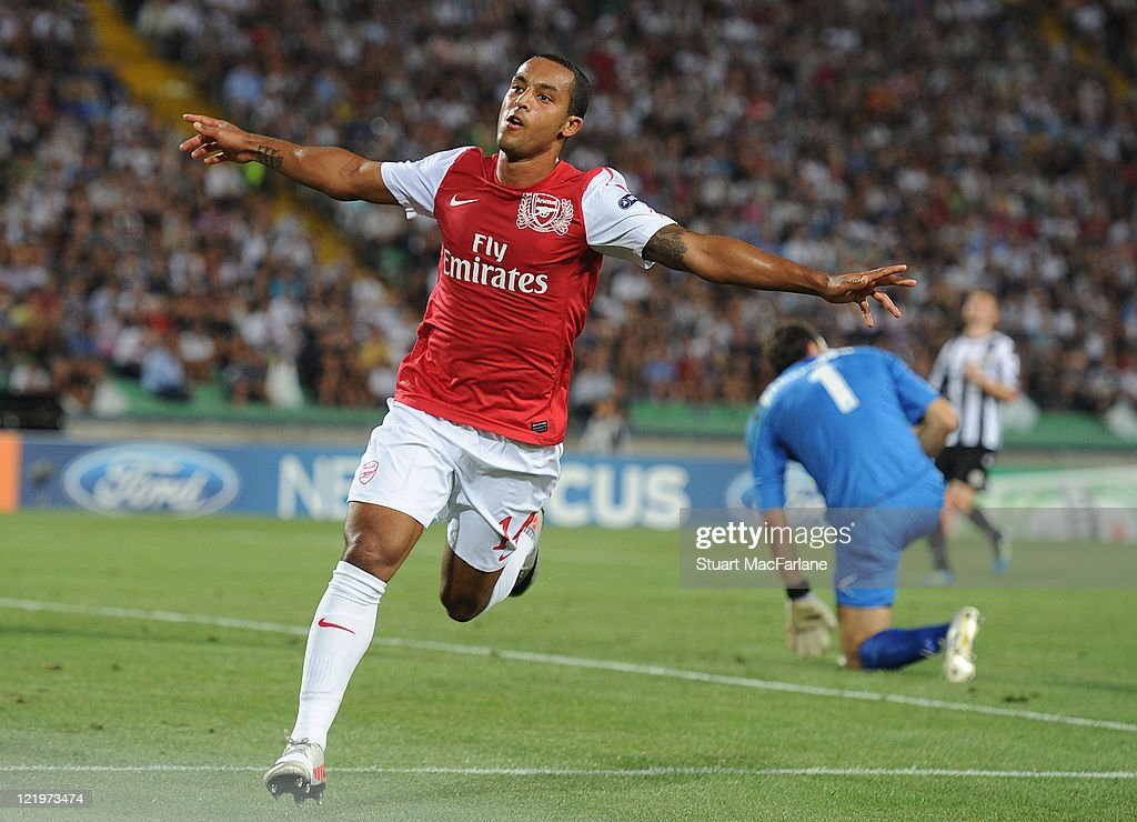 Theo Walcott celebrates scoring his team's second goal during the UEFA Champions League playoff second leg match between Udinese Calcio and Arsenal...