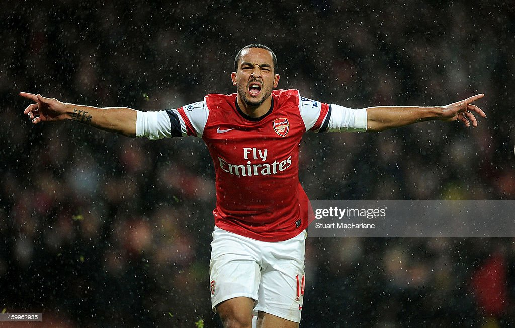 <a gi-track='captionPersonalityLinkClicked' href=/galleries/search?phrase=Theo+Walcott&family=editorial&specificpeople=451535 ng-click='$event.stopPropagation()'>Theo Walcott</a> celebrates scoring the 2nd Arsenal goal during the match at Emirates Stadium on January 1, 2014 in London, England.