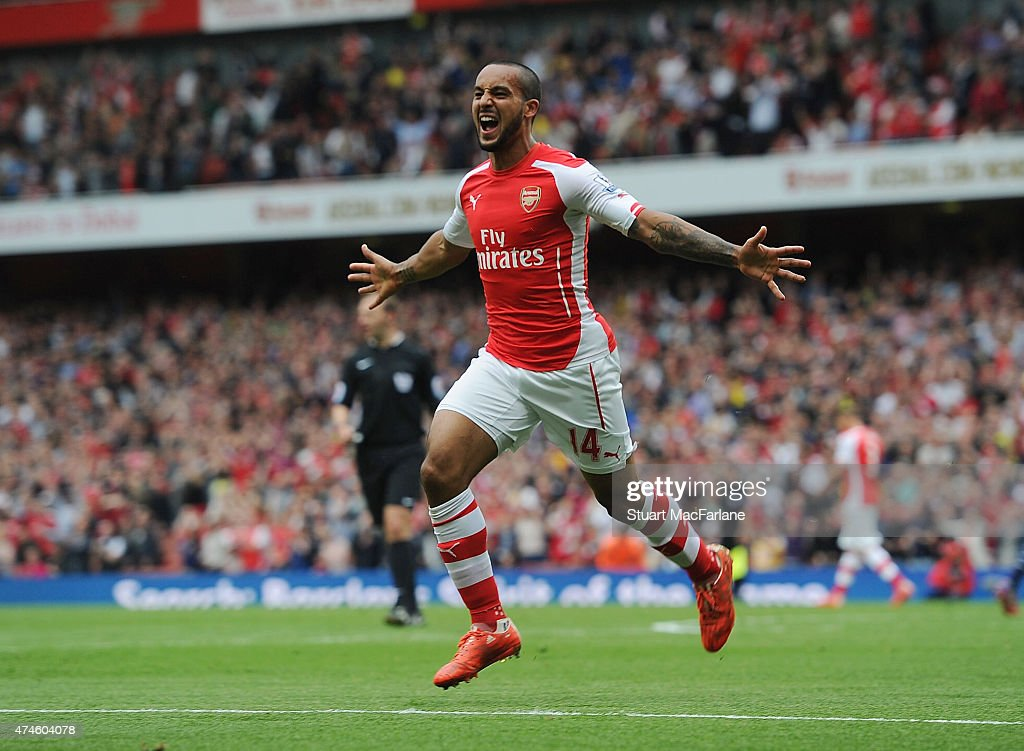 Theo Walcott celebrates scoring the 2nd Arsenal goal during the Barclays Premier League match between Arsenal and West Bromwich Albion at Emirates Stadium on May 24, 2015 in London, England.