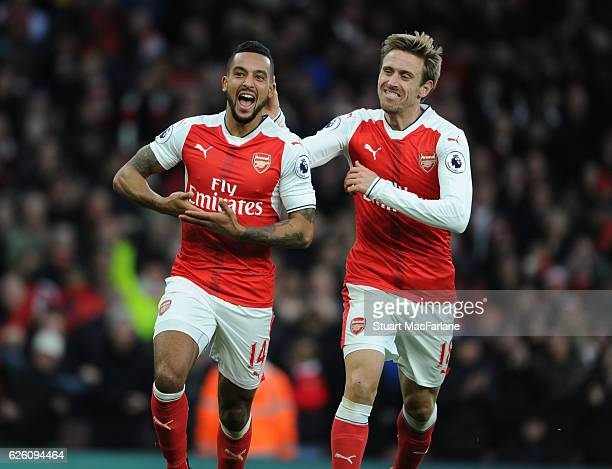 Theo Walcott celebrates scoring the 2nd Arsenal goal with Nacho Monreal during the Premier League match between Arsenal and AFC Bournemouth at...