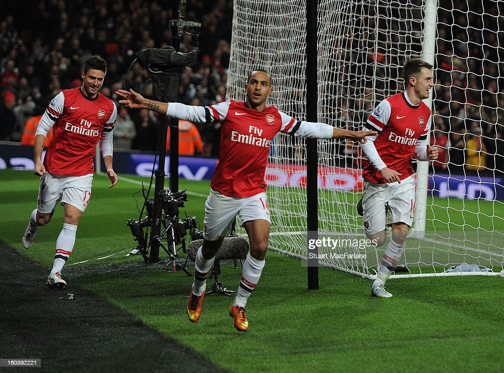 Theo Walcott celebrates scoring the 2nd Arsenal goal with (L) Olivier Giroud and (R) Aaron Ramsey during the Barclays Premier League match between Arsenal and Liverpool at Emirates Stadium on January 30, 2013 in London, England.