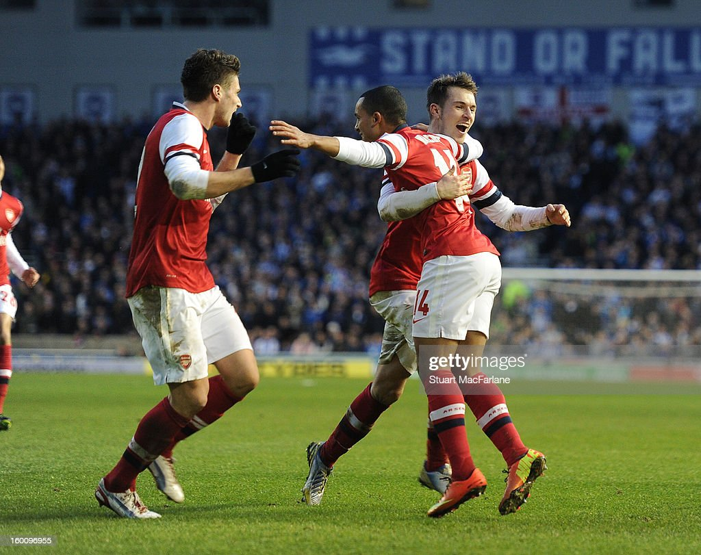 Theo Walcott celebrates scoring the 3rd Arsenal goal with (L) Olivier Giroud and (R) Aaron Ramsey during the FA Cup Fourth Round match between Brighton & Hove Albion and Arsenal at the Amex Stadium on January 26, 2013 in Brighton, England.