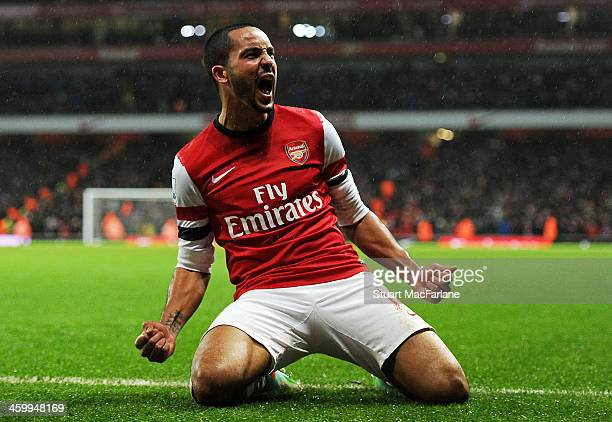 Theo Walcott celebrates scoring the second Arsenal goal during the match at Emirates Stadium on January 1 2014 in London England
