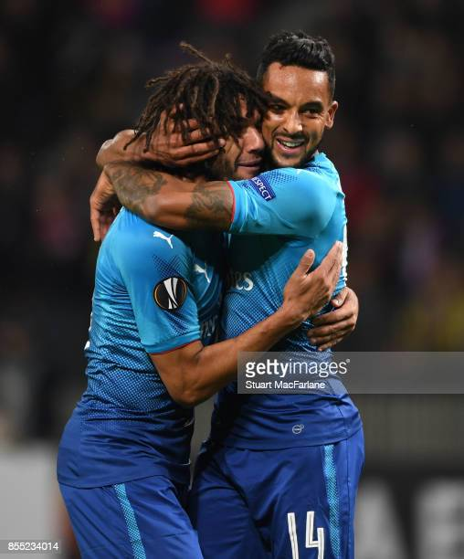 Theo Walcott celebrates scoring the second Arsenal goal with Mohamed Elneny during the UEFA Europa League group H match between BATE Borisov and...