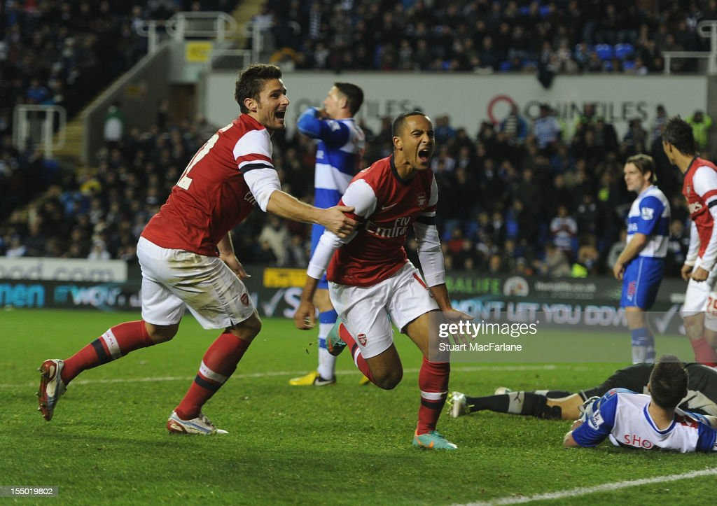 <a gi-track='captionPersonalityLinkClicked' href=/galleries/search?phrase=Theo+Walcott&family=editorial&specificpeople=451535 ng-click='$event.stopPropagation()'>Theo Walcott</a> celebrates scoring the sixth Arsenal goal with <a gi-track='captionPersonalityLinkClicked' href=/galleries/search?phrase=Olivier+Giroud&family=editorial&specificpeople=5678034 ng-click='$event.stopPropagation()'>Olivier Giroud</a> during the Capital One Cup match between Arsenal and Reading at Madejski Stadium on October 30, 2012 in Reading, England.