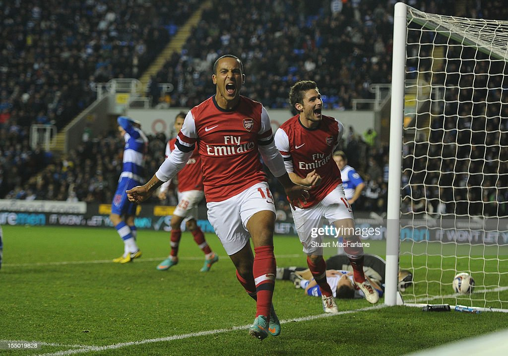 <a gi-track='captionPersonalityLinkClicked' href=/galleries/search?phrase=Theo+Walcott&family=editorial&specificpeople=451535 ng-click='$event.stopPropagation()'>Theo Walcott</a> celebrates scoring the sixth Arsenal goal with Olivier Giroud during the Capital One Cup match between Arsenal and Reading at Madejski Stadium on October 30, 2012 in Reading, England.