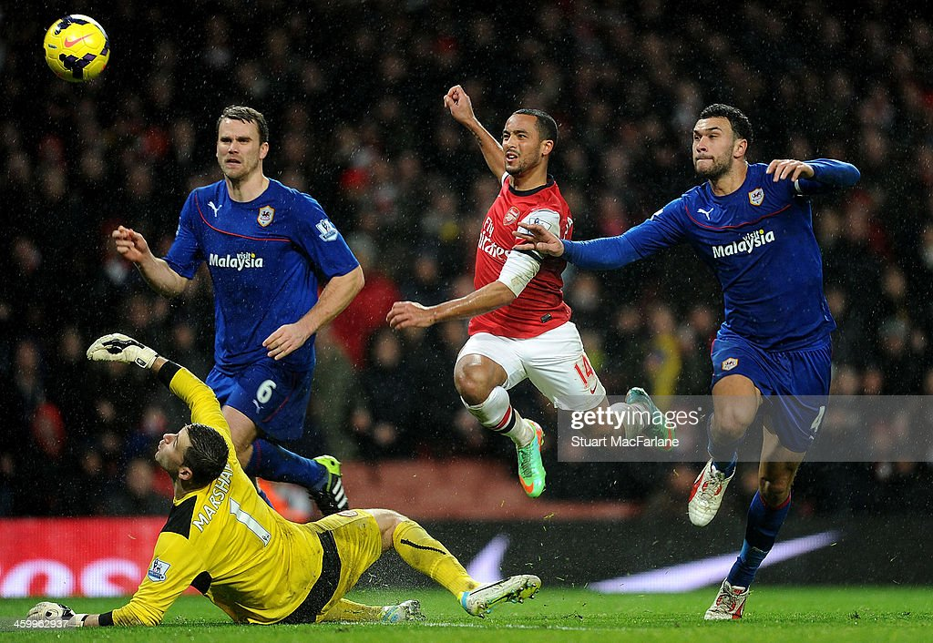 <a gi-track='captionPersonalityLinkClicked' href=/galleries/search?phrase=Theo+Walcott&family=editorial&specificpeople=451535 ng-click='$event.stopPropagation()'>Theo Walcott</a> chips the ball over Cardiff goalkeeper <a gi-track='captionPersonalityLinkClicked' href=/galleries/search?phrase=David+Marshall&family=editorial&specificpeople=4668874 ng-click='$event.stopPropagation()'>David Marshall</a> to score the 2nd Arsenal goal at Emirates Stadium on January 1, 2014 in London, England.