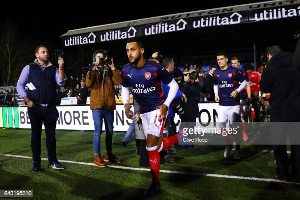 Theo Walcott Granit Xhaka and Rob Holding of Arsenal run out for the warmup before the Emirates FA Cup fifth round match between Sutton United and...