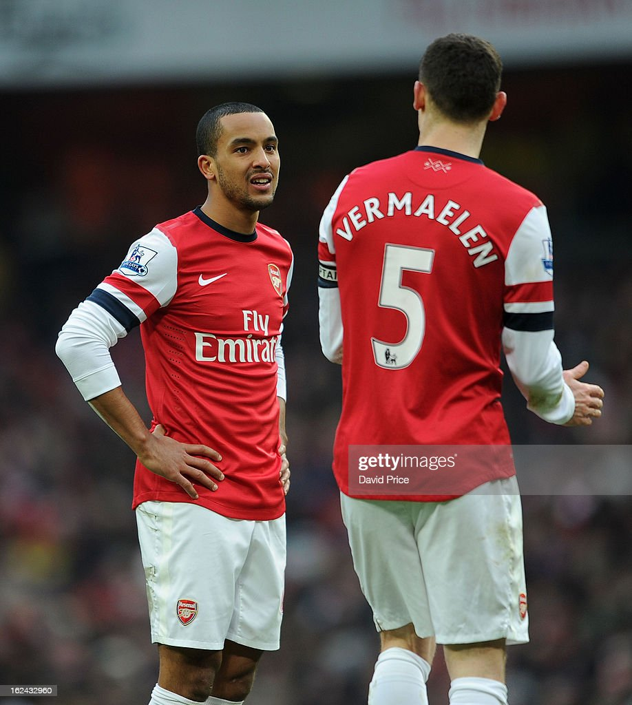 Theo Walcott has a chat with Thomas Vermaelen of Arsenal during the Barclays Premier League match between Arsenal and Aston Villa at Emirates Stadium on February 23, 2013 in London, England.