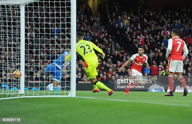 Theo Walcott heads past Bournemouth defender Nathan Ake to score the 2nd Arsenal goal during the Premier League match between Arsenal and AFC...