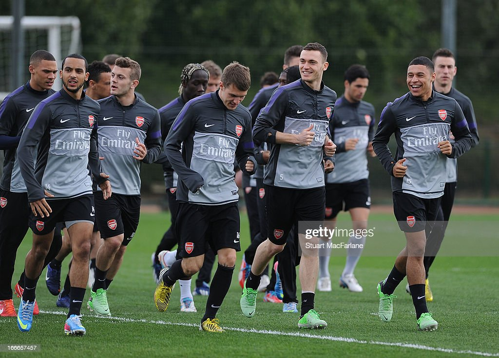 Theo Walcott, Jack Wilshere, Aaron Ramsey, Thomas Vermaelen and Alex Oxlade-Chamberlain of Arsenal during a training session at London Colney on April 15, 2013 in St Albans, England.