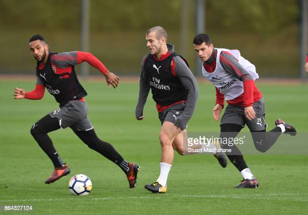 Theo Walcott Jack Wilshere and Granit Xhaka of Arsenal during a training session at London Colney on October 21 2017 in St Albans England