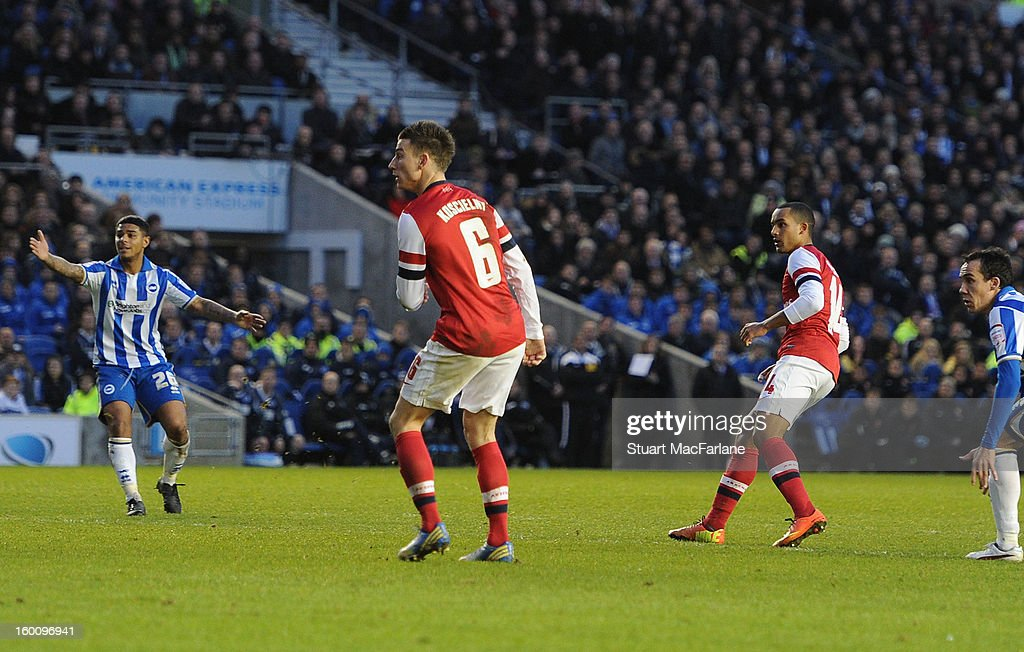 Theo Walcott looks on as his deflected shot goes into the net for the 3rd Arsenal goal during the FA Cup Fourth Round match between Brighton & Hove Albion and Arsenal at the Amex Stadium on January 26, 2013 in Brighton, England.
