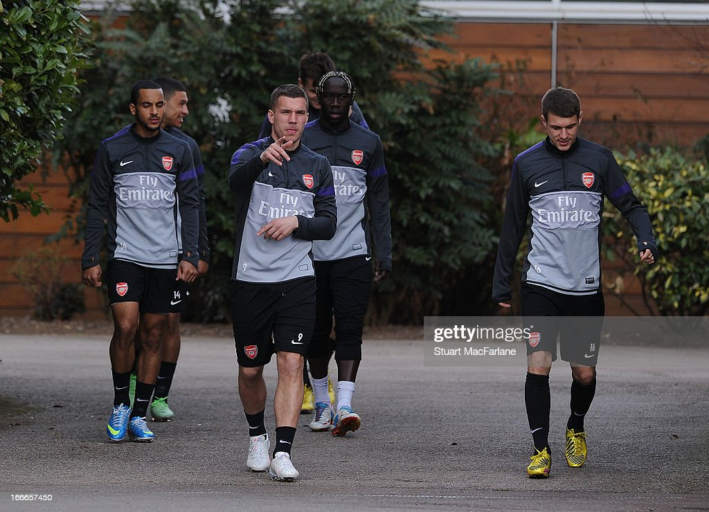 Theo Walcott, Lukas Podolski, Bacary Sagna and Aaron Ramsey of Arsenal before a training session at London Colney on April 15, 2013 in St Albans, England.