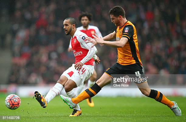 Theo Walcott of Arsenal and Alex Bruce of Hull City compete for the ball during the Emirates FA Cup fifth round match between Arsenal and Hull City...