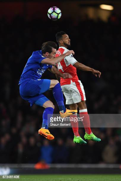 Theo Walcott of Arsenal and Christian Fuchs of Leicester City clash during the Premier League match between Arsenal and Leicester City at the...