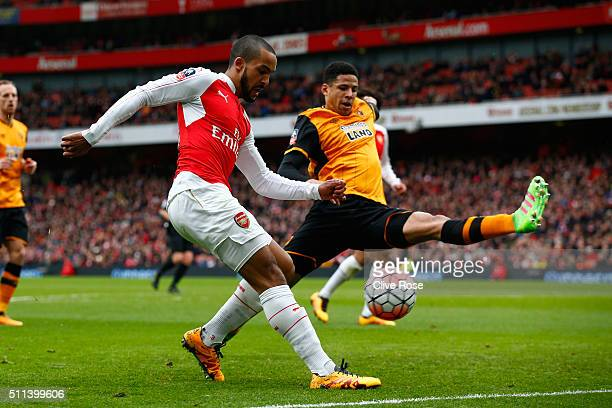 Theo Walcott of Arsenal and Curtis Davies of Hull City compete for the ball during the Emirates FA Cup fifth round match between Arsenal and Hull...