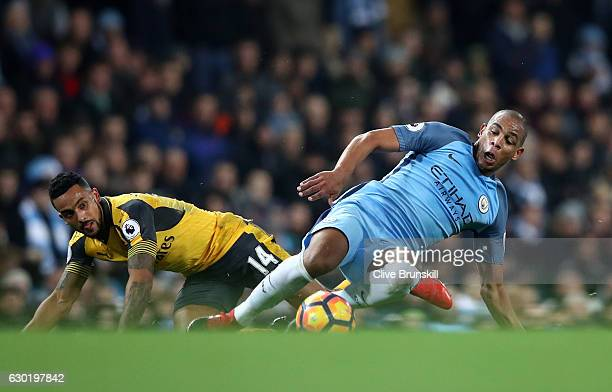 Theo Walcott of Arsenal and Fernando of Manchester City battle for possession during the Premier League match between Manchester City and Arsenal at...