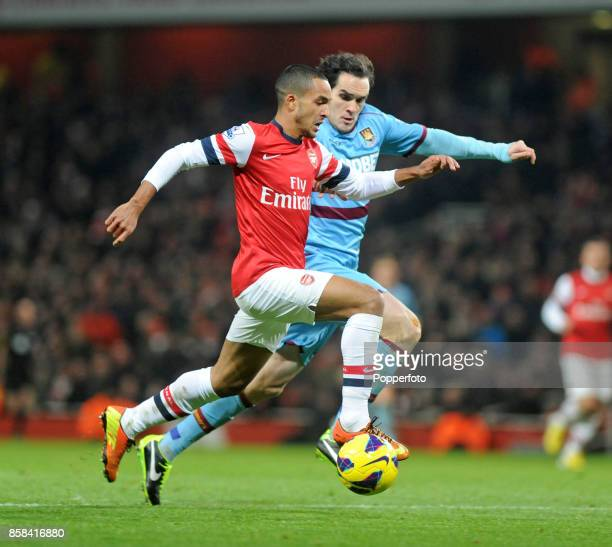 Theo Walcott of Arsenal and Joey O'Brien of West Ham in action during the Barclays Premier League match between Arsenal and West Ham United at the...