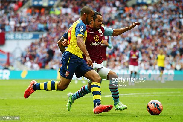 Theo Walcott of Arsenal and Kieran Richardson of Aston Villa battle for the ball during the FA Cup Final between Aston Villa and Arsenal at Wembley...