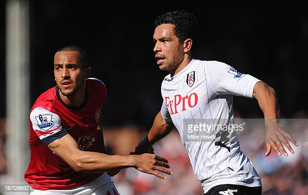 Theo Walcott of Arsenal and Kieran Richardson of Fulham look on during the Barclays Premier League match between Fulham and Arsenal at Craven Cottage...