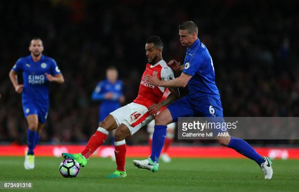 Theo Walcott of Arsenal and Robert Huth of Leicester City during the Premier League match between Arsenal and Leicester City at Emirates Stadium on...