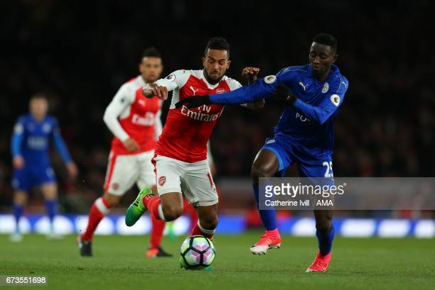 Theo Walcott of Arsenal and Wilfred Ndidi of Leicester City during the Premier League match between Arsenal and Leicester City at Emirates Stadium on...
