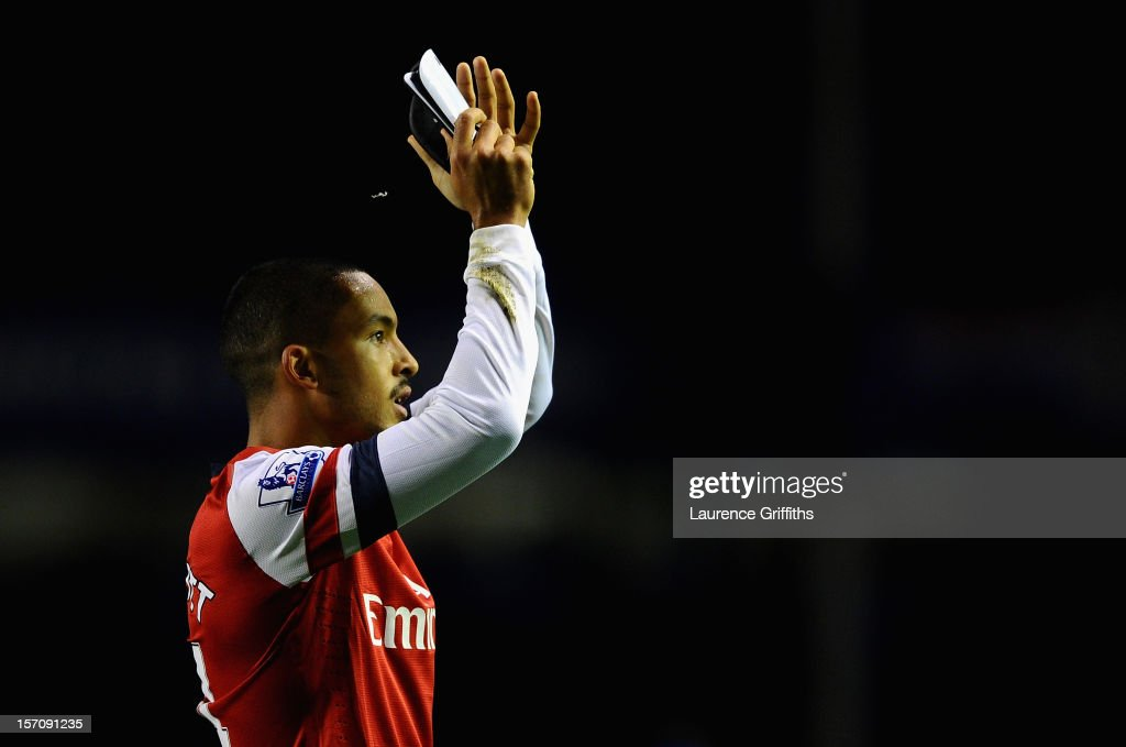 Theo Walcott of Arsenal applauds the fans at the end of the Barclays Premier League match between Everton and Arsenal at Goodison Park on November 28, 2012 in Liverpool, England.