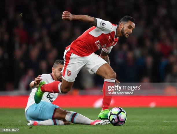 Theo Walcott of Arsenal breaks past Manuel Lanzini of West Ham during the Premier League match between Arsenal and West Ham United at Emirates...