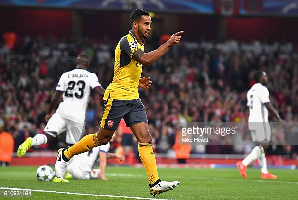Theo Walcott of Arsenal ceclebrates after scoring the opening goal during the UEFA Champions League group A match between Arsenal FC and FC Basel...