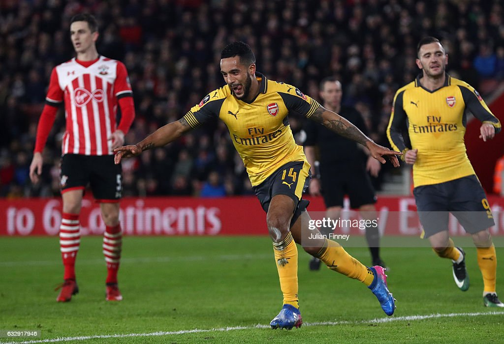 Theo Walcott of Arsenal celebrates after scoring his sides third goal during the Emirates FA Cup Fourth Round match between Southampton and Arsenal at St Mary's Stadium on January 28, 2017 in Southampton, England.
